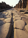Close Up of a Chariot Rut in Ancient Roman Streets in Pompeii, Italy Photographic Print by Richard Nowitz