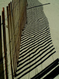 Beach Fence and its Shadow Meander Up the Beach Photographic Print by Todd Gipstein