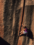 Climber Ascends an Off Width in the Utah Desert Photographic Print by Bill Hatcher