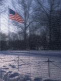 American Flag Reflected in the Vietnam Memorial, Washington, D.C. Photographic Print by Stacy Gold