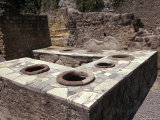 Ancient Corner Wine Bar with Pottery Vats for Beverages in Herculaneum, Italy Fotografie-Druck von Richard Nowitz