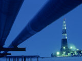 Alaska Oil Pipeline and Oil Rig at Night Photographic Print by Kenneth Garrett