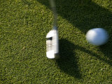 Close View of a Putter Hitting a Golf Ball, Groton, Connecticut Photographic Print by Todd Gipstein