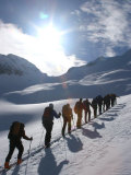 Back Country Skiiers Trudge Uphill in a Straight Line Photographic Print by Skip Brown
