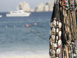 Close Up View of Beaded Necklaces on the Beach, Cabo San Lucas, Mexico Photographic Print by Gina Martin