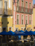 Balconies on Painted Houses Overlooking Tables with Umbrellas, Guanajuato, Mexico Photographic Print by David Evans