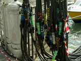 Cables Hanging Beside Marble Posts Along a Canal in Venice, Italy Photographic Print by Todd Gipstein