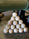 Cannon Balls Stacked Next to the Barrel of a Cannon at the Arsenale, Venice, Italy Photographic Print by Todd Gipstein