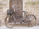 Bicycle Leaning against a Stone Wall in Parma, Italy Photographic Print by Gina Martin