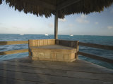 Ambergris Caye Pier Chair and Boats on the Horizon near San Pedro, Belize Photographic Print by James Forte