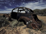 Burnt Out Antique Car Wreck Discarded to Rust Away in the Desert, Australia Photographic Print by Jason Edwards