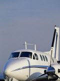 Closeup of an Airplane on the Tarmac Photographic Print by Kenneth Garrett