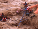Action Shot of Boatmen Rafting Through Mudding Rapids During a Flood, Colorado Photographic Print by Kate Thompson
