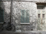 Bicycle Leaning against a Stone House in Ravenna, Italy Photographic Print by Gina Martin