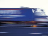 Blurred Speeding Semitrailer Truck Races Along the Highway, Australia Photographic Print by Jason Edwards