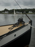Bow of a Boat with a Sailboat in the Background on the Mystic River, Connecticut Photographic Print by Todd Gipstein