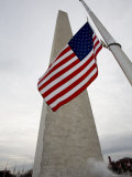 American Flag against the Washington Monument, Washington, D.C. Photographic Print by Tim Laman