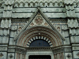 Close View of Top of One of the Portals to the Duomo di Siena, Tuscany, Italy Photographic Print by Todd Gipstein