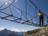 Climber Walks Across a Cable Bridge on a Via Feratta Up Piz Boe, Italy Photographic Print by Bill Hatcher