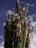Cluster of Tibetan Prayer Flags against a Blue Sky with Clouds, Qinghai, China Photographic Print by David Evans
