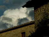 10th Century Tuscan Villa against a Dramatic Cloudy Sky, Tuscany, Italy Photographic Print by Todd Gipstein