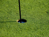 Close View of a Flag Pole in a Hole on a Golf Course, Groton, Connecticut Photographic Print by Todd Gipstein