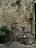 Antique Rusted Bicycle Leans against a Stone Wall, Asolo, Italy Photographic Print by Todd Gipstein
