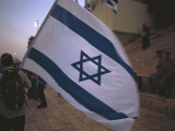 Israel, Jerusalem: Israeli Flag Being Waved at the Wailing Wall Photographic Print by  Brimberg & Coulson