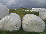 Iceland: Plastic Wrap Protects Hay from Rain Storm Photographic Print by  Brimberg & Coulson