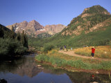 Hikers Walk Along a Trail in Maroon Bells Wilderness Area in Colorado Photographic Print by Richard Nowitz