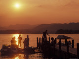 Group of People at a Pier at Lake Windermere During Sunset in the Lake District in England Photographic Print by Richard Nowitz