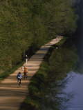 Bikers on the C and O Canal Path in Washington, D.C. Photographic Print by Phil Schermeister
