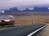 Fog Obscures Monument Valley, Utah Photographic Print by Bill Hatcher