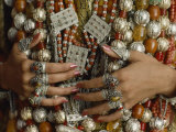 Close-Up of a Bride&#39;s Hands Displays Silver Rings against Necklaces Photographic Print by James L. Stanfield