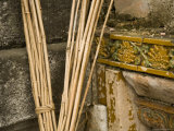 Brooms Rest against Ancient Wall of Chinese Mausoleum, China Photographic Print by David Evans