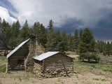 Image of Old Cabin and Fences of Olivas Camp with Approaching Storm, California Photographic Print by Rich Reid