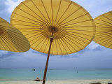 Beach from Underneath Yellow Umbrellas at the Amanpuri Hotel Photographic Print by Jodi Cobb