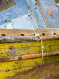 Colorful, Weather Beaten Boat Deteriorates on Chilean Shore Photographic Print by David Evans