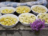 Flowers Next to Wild Mushrooms for Sale in Bowls, Qinghai, China Photographic Print by David Evans