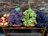 Grapes and Nectarines on a Bench at a Siena Market, Tuscany, Italy Photographic Print by Todd Gipstein