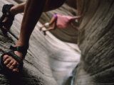 Detail of Sandals and Hikers in a Slot Canyon in Arizona Photographic Print by Bobby Model