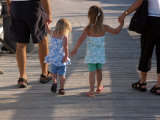 Grandchildren Walk Down a Wooden Pier with their Grandparents Photographic Print by Stacy Gold