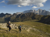 Hikers Descend a Trail to Pordoi Pass in the Dolomites, Italy Photographic Print by Bill Hatcher