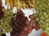 Grapes and Bananas Hanging at an Outdoor Market, San Cristobal de Las Casas, Mexico Photographic Print by Gina Martin
