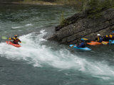 Kayaker Plays in a Wave on the Bow River Photographic Print by Bill Hatcher