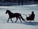 Horse-Drawn Sleigh Ride at Twilight in a Snowy Landscape Photographic Print by Ira Block