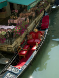 Fancy Gondola Parked in a Canal Next to a Restaurant, Venice, Italy Photographic Print by Todd Gipstein