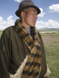Informal Portrait of a Nomadic Sheep Herder and his Flock, Qinghai, China Photographic Print by David Evans