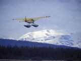 Floatplane Taking Off over the Kenai Mountains, Alaska Photographic Print by Rich Reid
