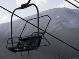 Empty Chair Lift at a Ski Resort Photographic Print by Tim Laman